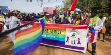 Demonstrators march in an LGBT pride parade in Uganda.