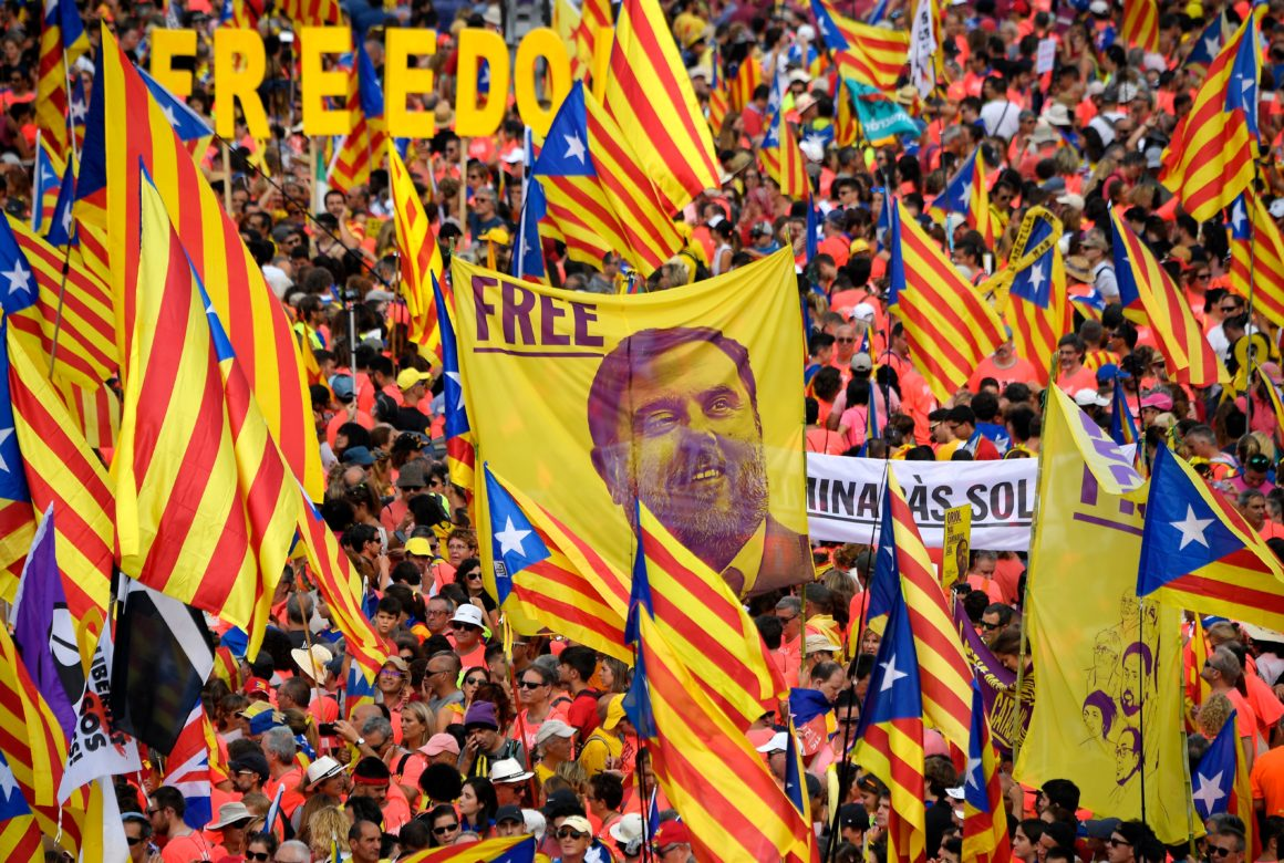 Demonstrators hold a banner demanding freedom for Catalan jailed leader Oriol Junqueras as they gather to take part in a pro-independence demonstration in Barcelona, on September 11, 2018, marking the National Day of Catalonia