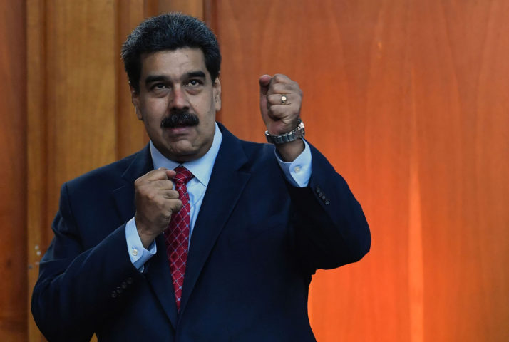 Venezuelan President Nicolas Maduro leaves after offering a press conference in Caracas, Venezuela, on January 25, 2019