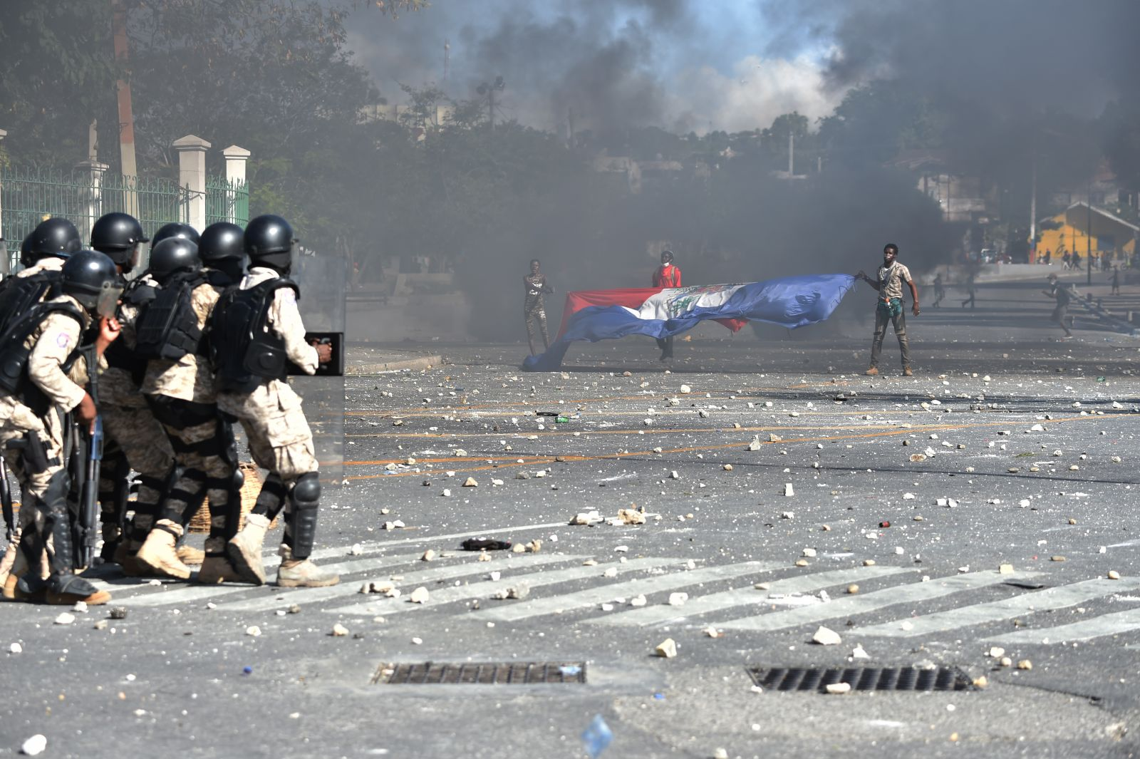 Police try to break up a protest in front of the National Palace in Haiti capital Port-au-Prince