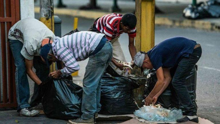 People scavenging for food in the streets of Venezeula's capital Caracas