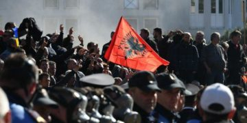 Opposition supporters protesting outside Albania's parliament in February