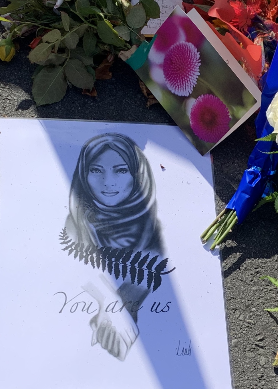 Poster showing muslim woman, New Zealand's silver fern, and the text 'you are us'