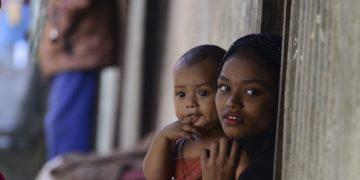 Myanmar Rohingya refugees look on in a refugee camp in Teknaf, in Bangladesh's Cox's Bazar, on November 26, 2016
