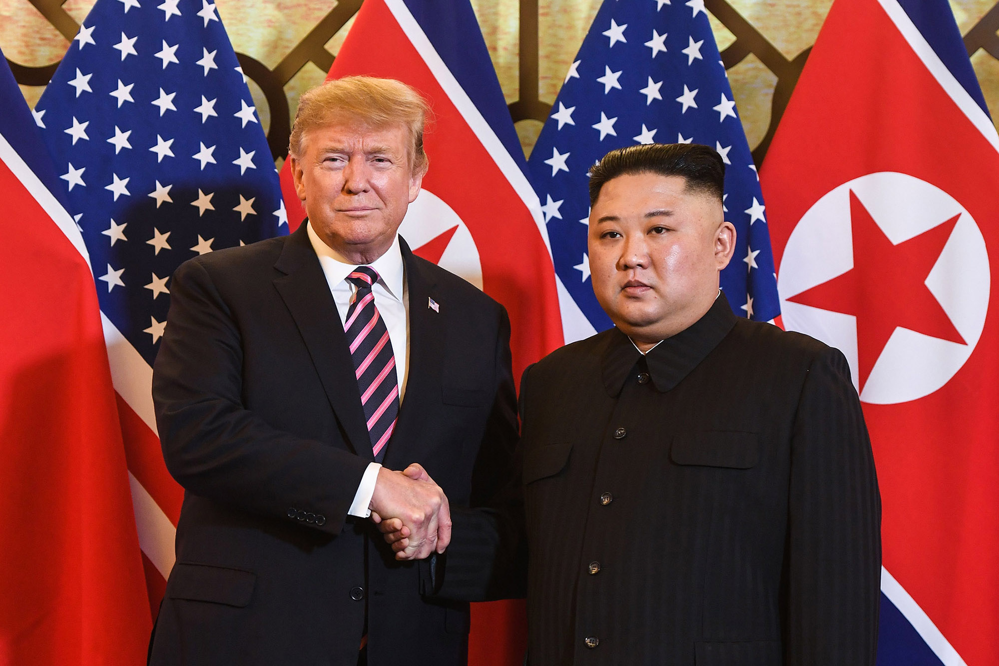 US President Donald Trump shakes hands with North Korea's leader Kim Jong Un before a meeting at the Sofitel Legend Metropole hotel in Hanoi on February 27, 2019