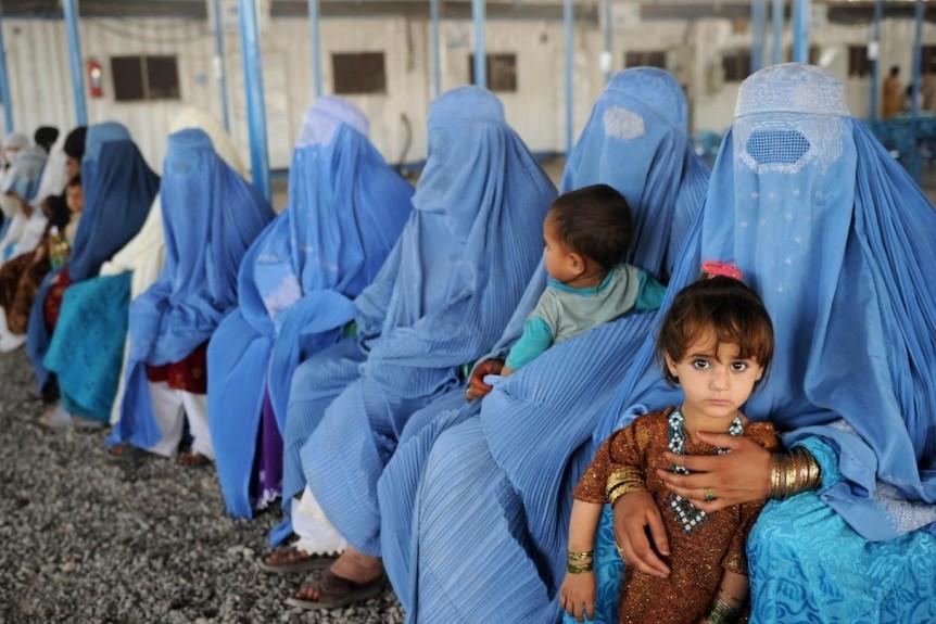 Women in Afghanistan wearing a blue burqa