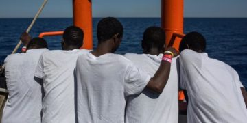Sudanese migrants sit on deck of Aquarius search and rescue ship in 2017