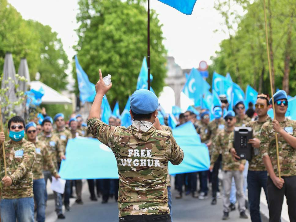 """Ethnic Uyghurs take part in a protest march asking for the European Union to call upon China to respect human rights in the Chinese Xinjiang region and asking for the closure of """"re-education centers."""""""