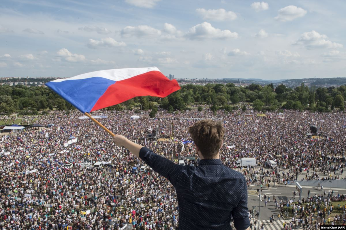 A man waves a Czech Republic flag over a huge crowd during an anti-Babis protest in the capital Prague.