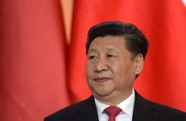 Chinese President Xi Jinping listens to a speech