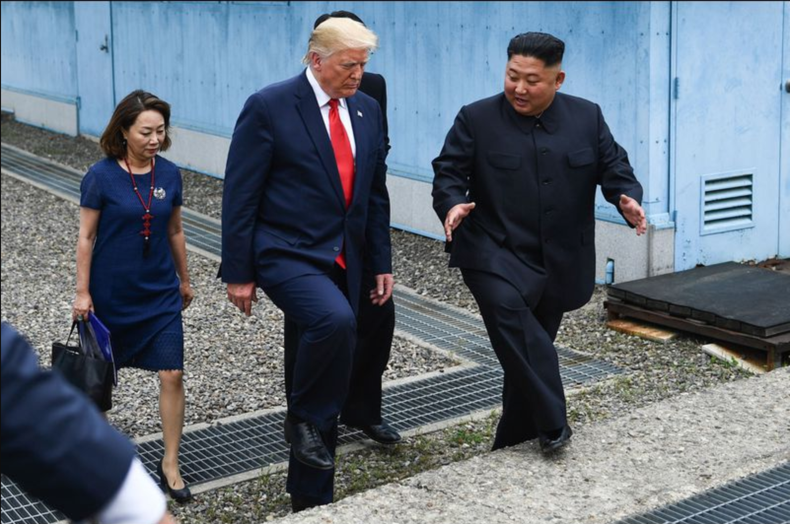President Donald Trump and North Korean leader Kim Jong Un walk together south of the Military Demarcation Line