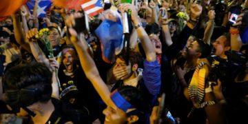 Demostrators erupt in celebration after Puerto Rican Governor Ricardo Rossello.
