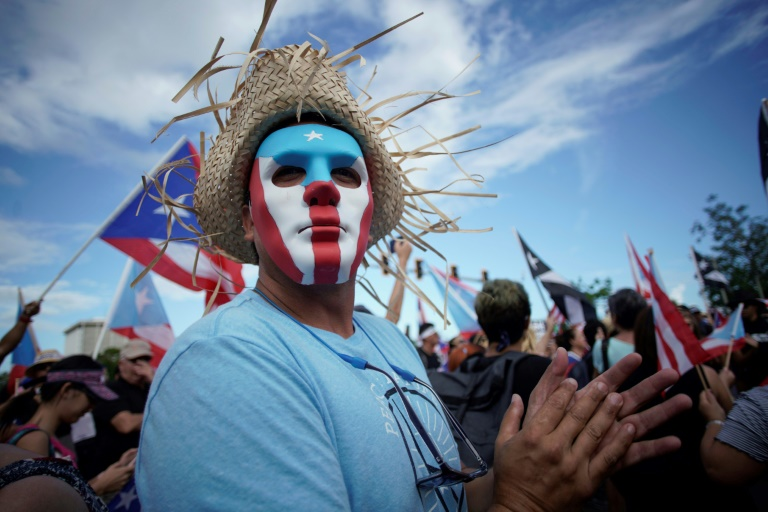 Protestor in Puerto Rico, where the nation angry over corruption and the release of insulting text chats