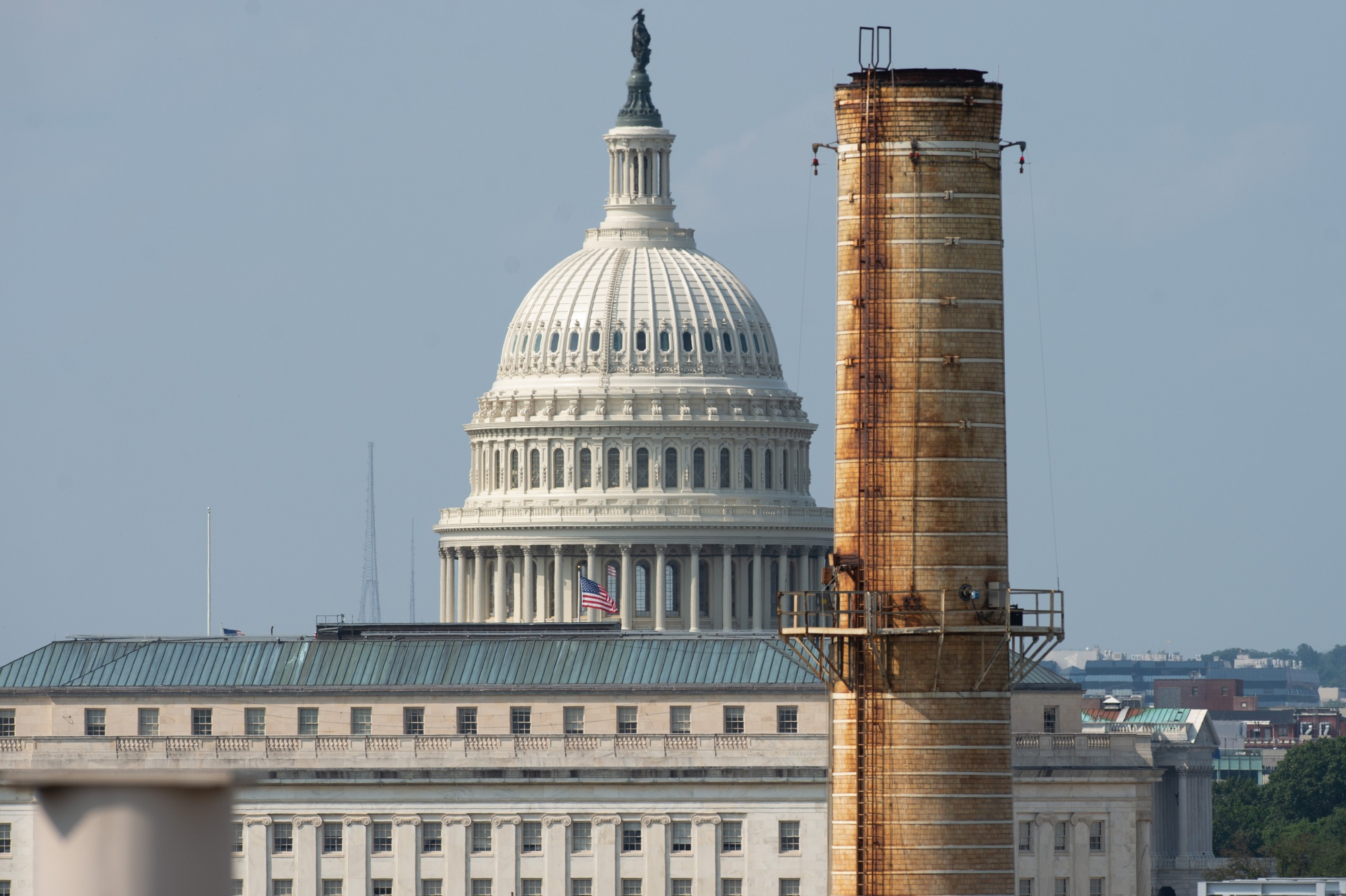 The chimney stacks of a natural gas and coal burning power plant that provides steam and chilled water for heating and cooling of the US Capitol and surrounding buildings