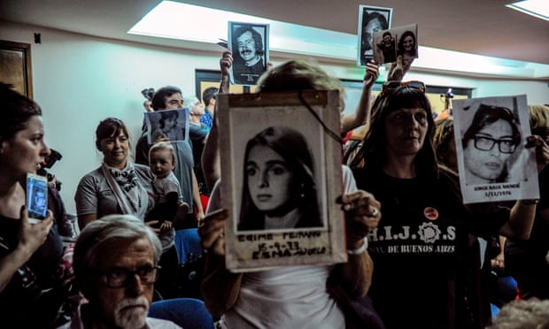 "Argentinian relatives of disappeared persons hold pictures during the trial of a pilot who flew ""death flights,"" 2017."