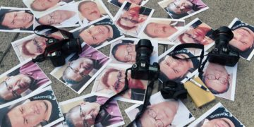 Cameras and photos of journalists killed across Mexico are placed on the ground during a protest on May 15, 2017, in Mexico City