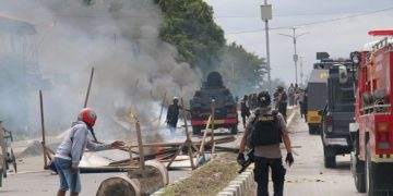 Indonesian officials confront protesters in Timika city in the restive Papua province