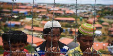 Rohingya refugees pray in the Kutupalong refugee camp in Ukhia, Bangladesh, Aug. 25, 2018