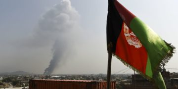 Smoke rises from the site of an attack on Tuesday after a massive explosion the night before near the Green Village in Kabul, Afghanistan