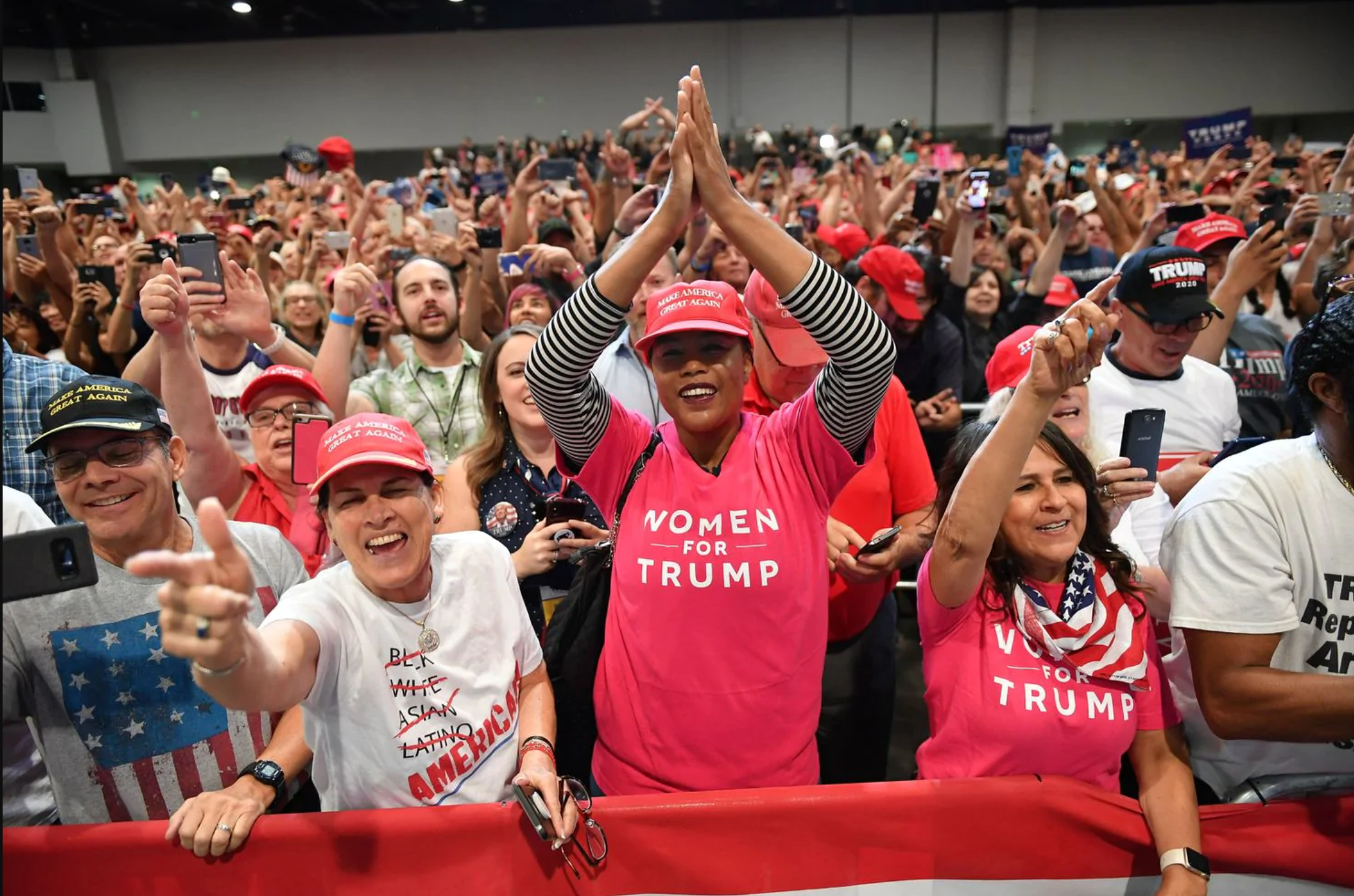 Supporters of President Trump cheer during a 'Make America Great Again' rally in 2018