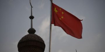 The Chinese flag flies over a mosque in Kashgar, Xinjiang