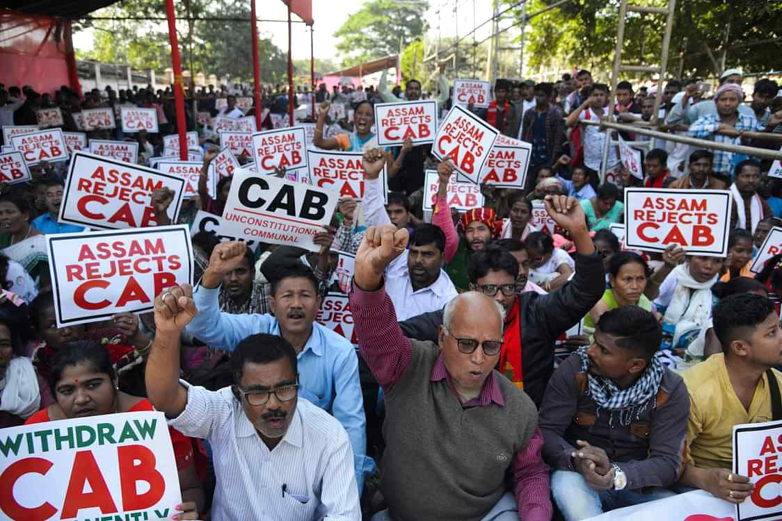 Activists shout slogans during a demonstration against the government's Citizenship Amendment Bill, in Guwahati on December 5, 2019