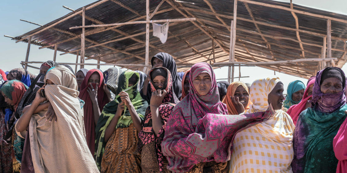 People gather prior to a food distribution at the Internally displaced person camp (IDP) of Farburo in Gode, near Kebri Dahar, southeastern Ethiopia, on January 27, 2018