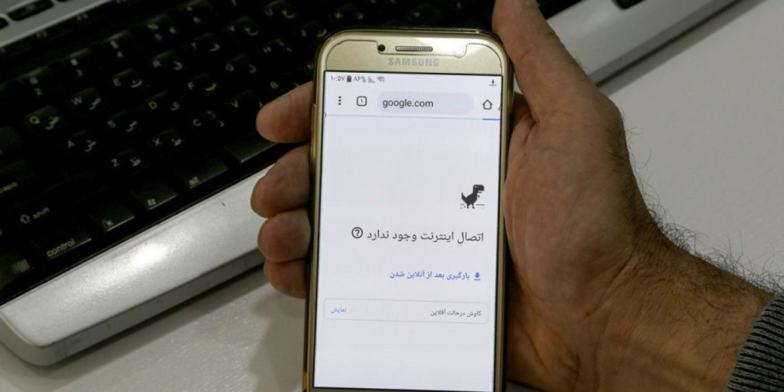 A man gets an error message while attempting to access the internet on his phone at an office in Iran's capital Tehran, November 17.