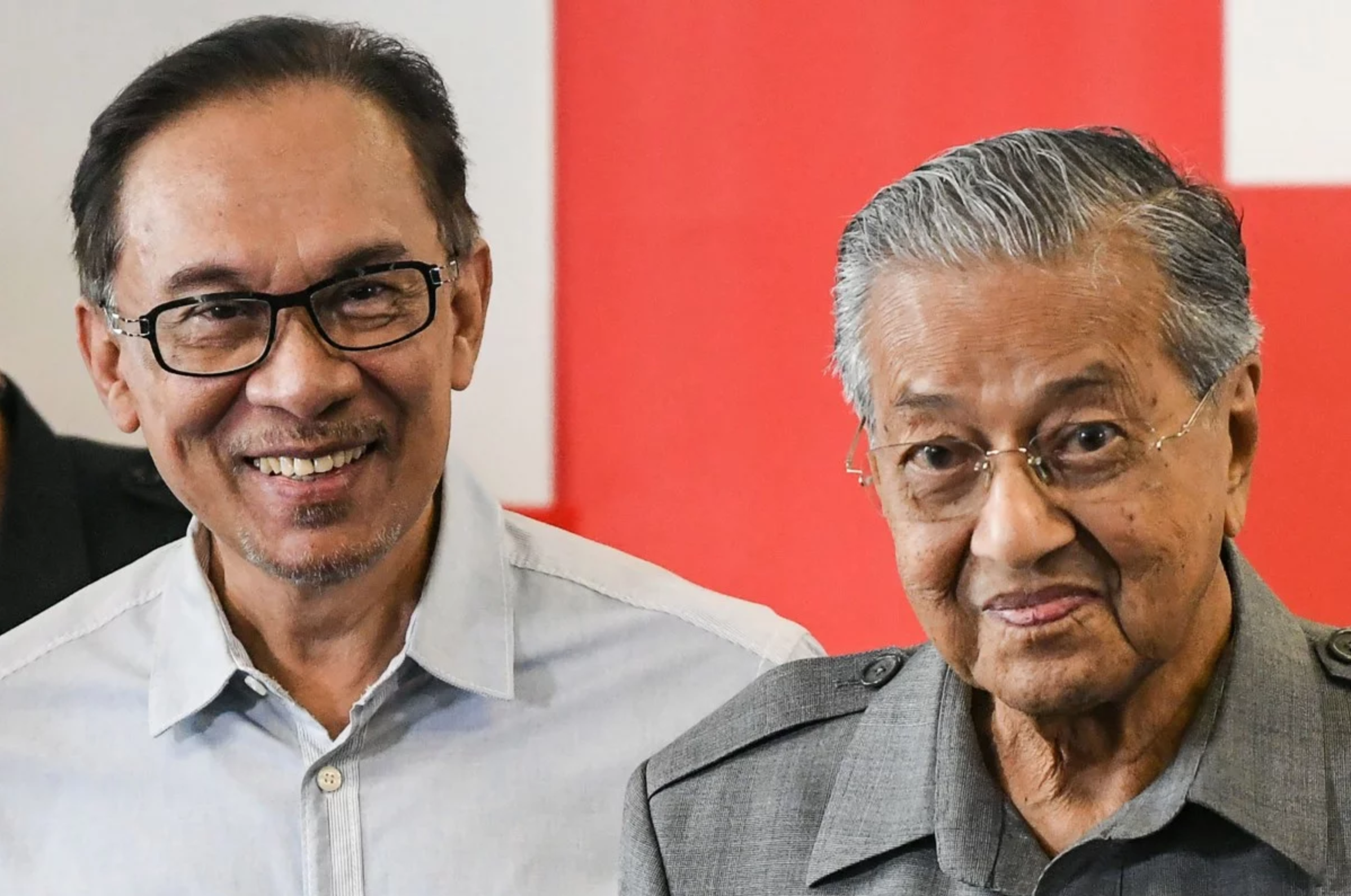 In this file photo taken on June 1, 2018, Malaysia's Prime Minister Mahathir Mohamad (R) and politician Anwar Ibrahim leave after a press conference in Kuala Lumpur.