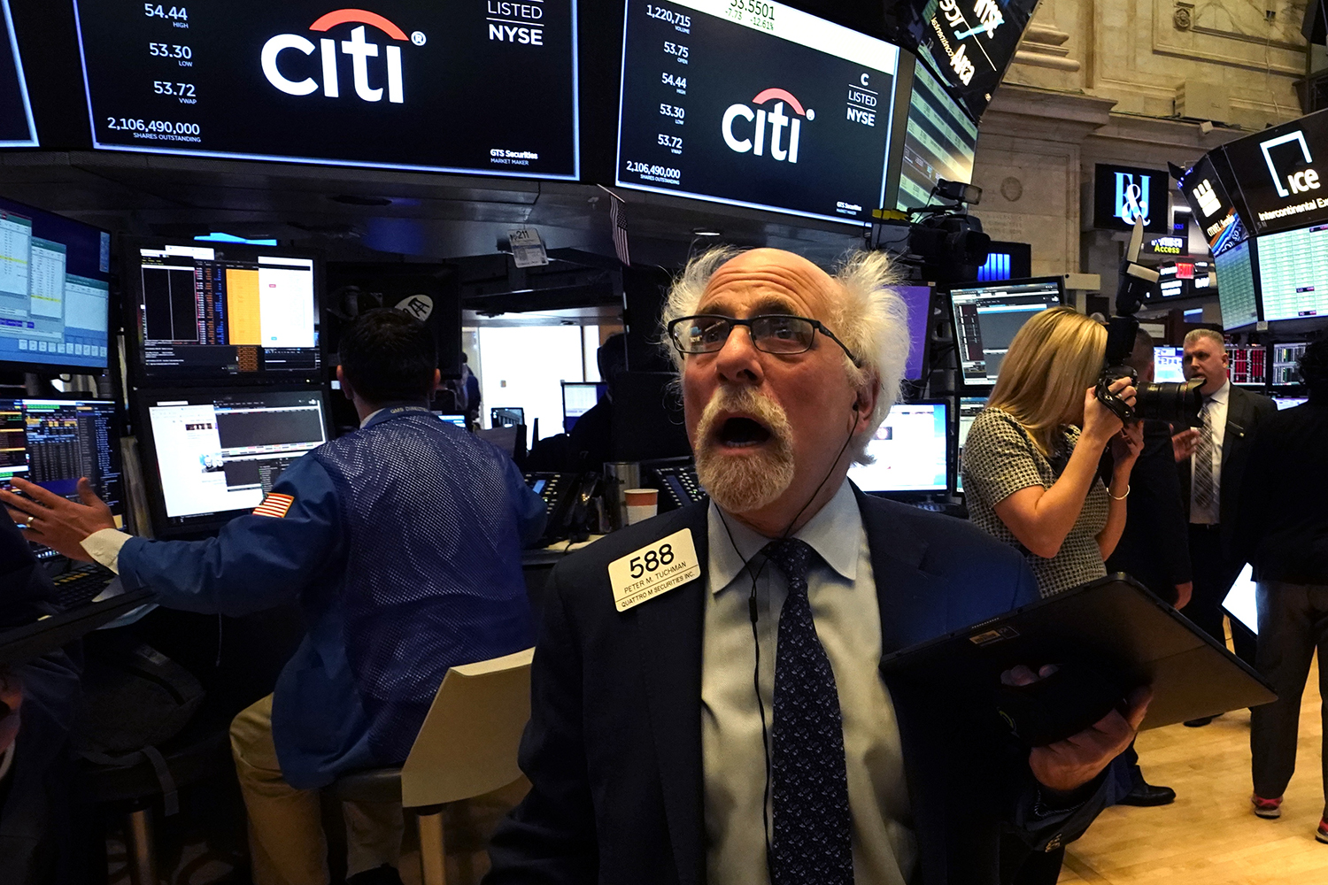 Peter Tuchman reacts as he works the floor during the opening bell at the New York Stock Exchange on March 9