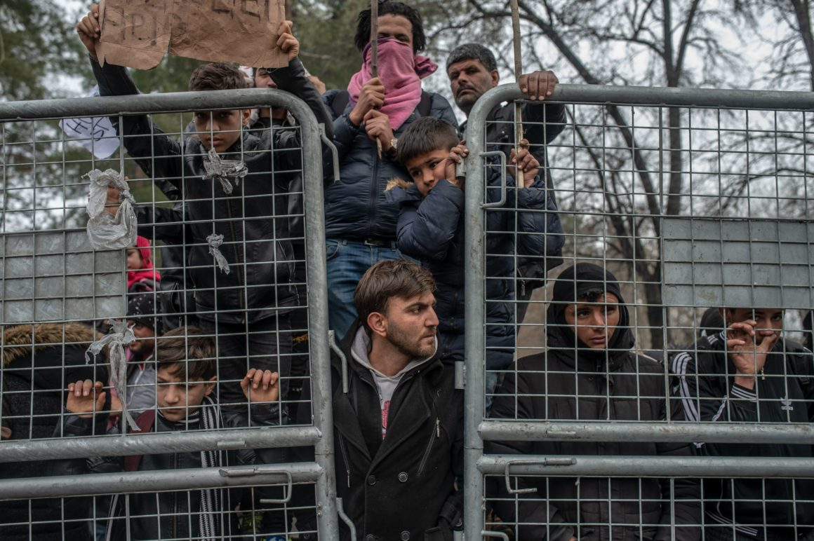 Migrants wait in the buffer zone at the Turkey-Greece border, near the Pazarkule crossing gate in Edirne, Turkey, on March 5, 2020