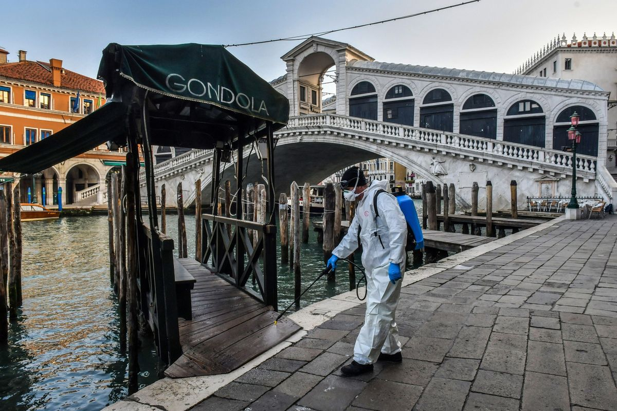 A health official sprays disinfectant in Venice, Italy amid the COVID-19 pandemic