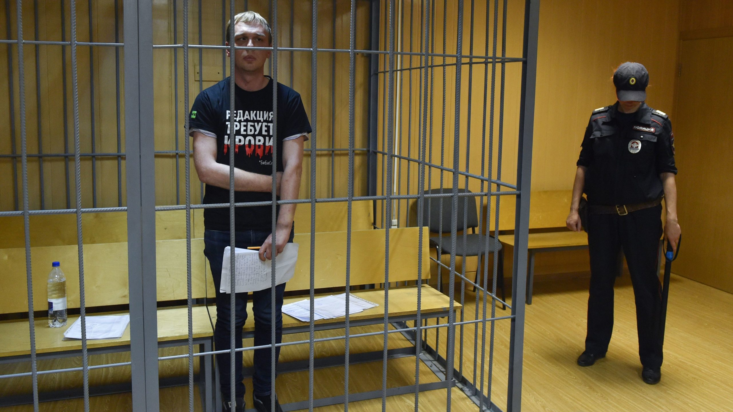 Russian investigative journalist Ivan Golunov inside the defendants' cage during a court hearing in Moscow.