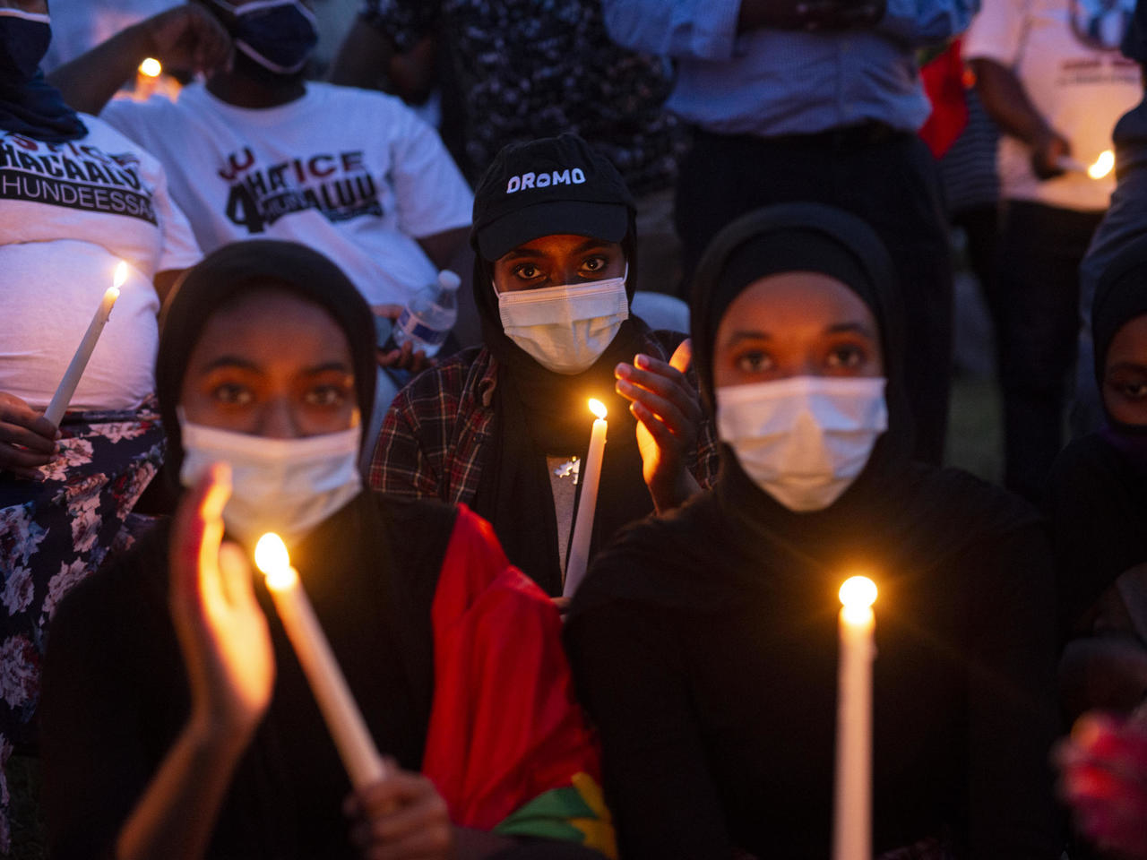 A candlelight vigil for the late musician and activist Haacaaluu Hundeessaa at the Oromo Community of Minnesota building in St Paul, Minnesota, on June 30, 2020