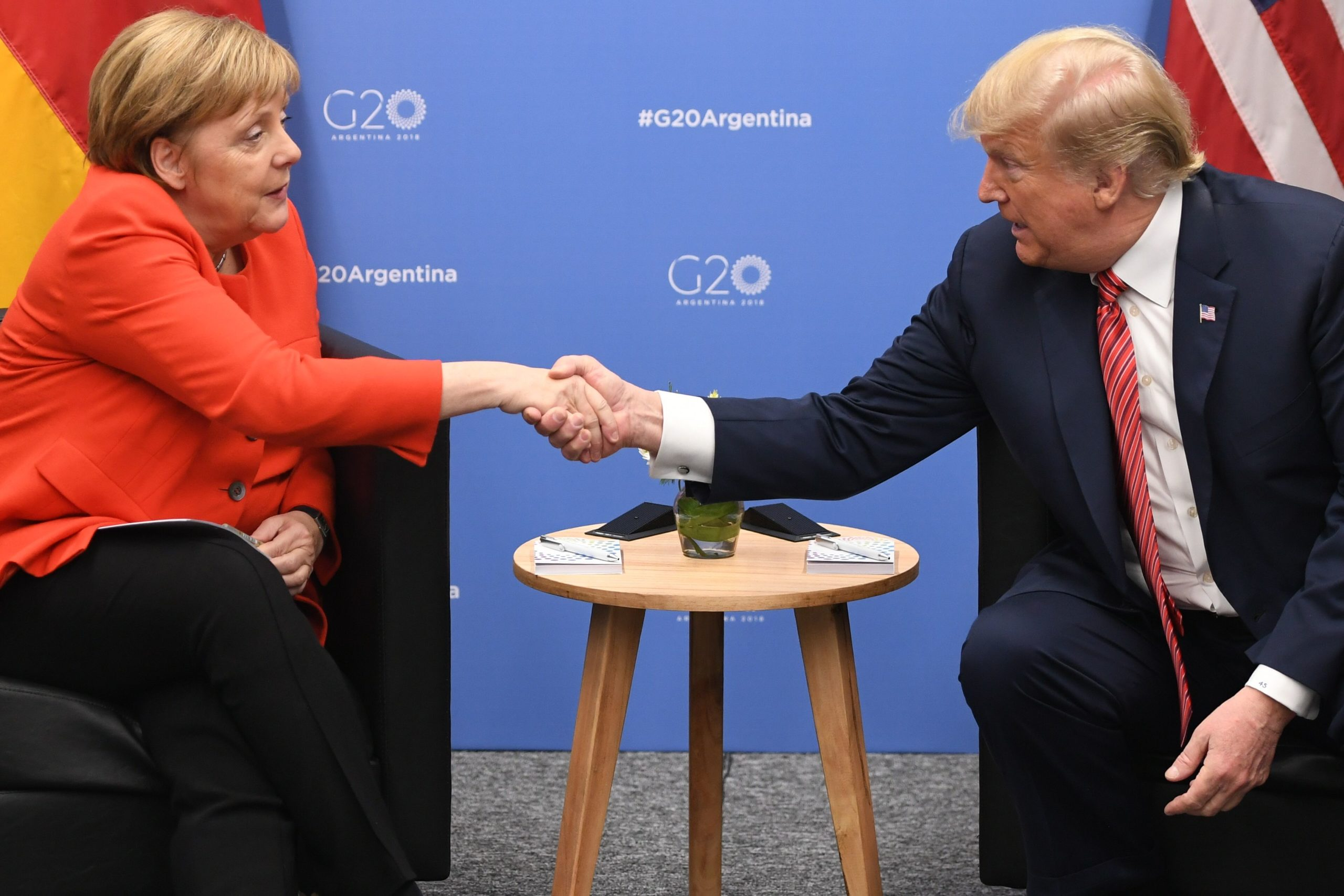 President Trump and Chancellor Merkel shaking hands at G20 summit in December 2018.