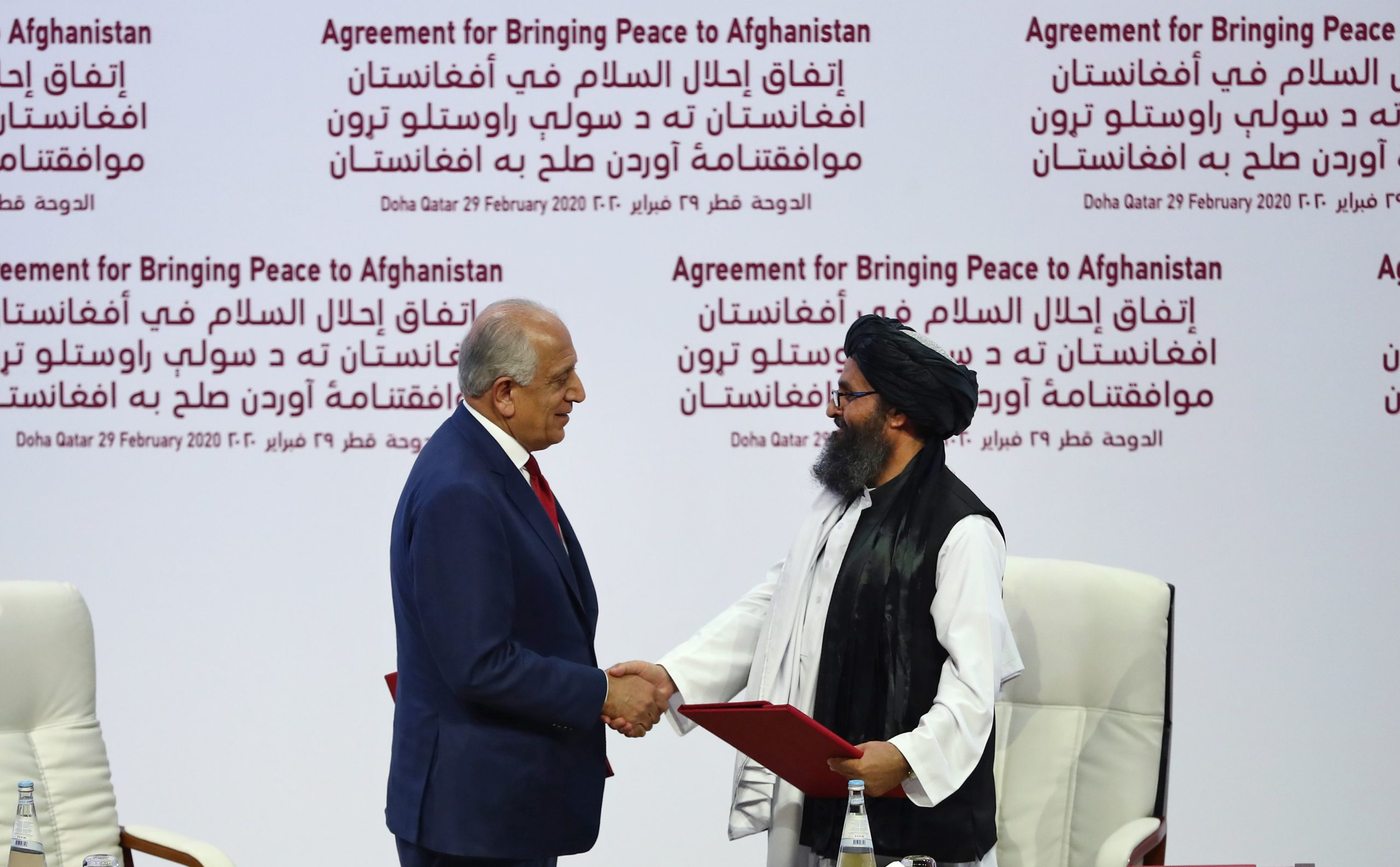 US Special Representative Zalmay Khalilzad and Taliban co-founder Mullah Abdul Ghani Baradar meeting in Doha, Qatar in February for peace talks.
