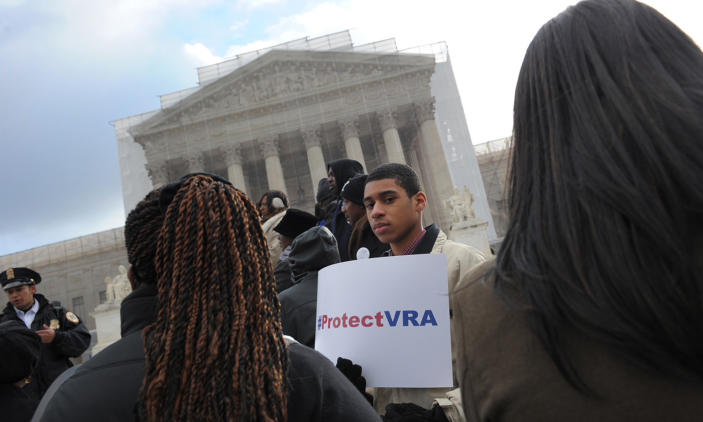 An activist protests outside of the US Supreme Court on February 27, 2013 as the Court prepares to hear Shelby County v. Holder. Photo: Mandel Ngan/AFP.