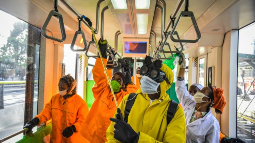 Cleaning staff disinfect a metro carriage in Addis Ababa, Ethiopia.