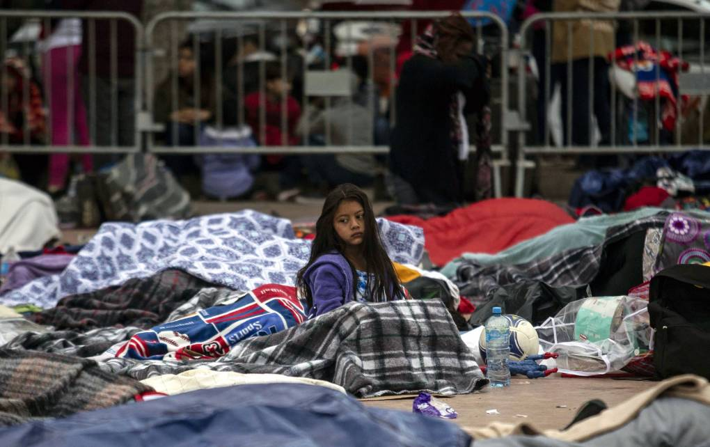 """Central American migrants traveling in the """"Migrant Via Crucis"""" caravan sleep outside """"El Chaparral"""" port of entry to the US."""