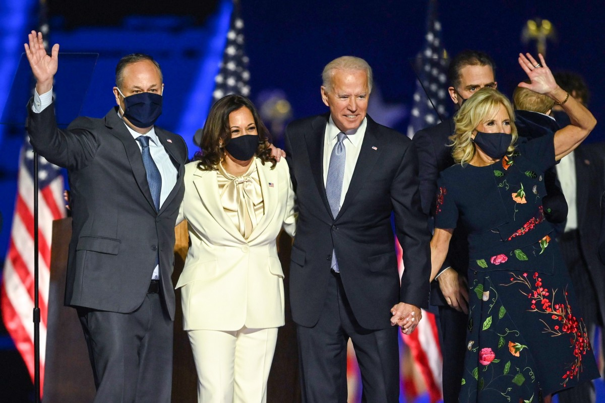 Joe Biden and Kamala Harris stand with their spouses Jill Biden and Doug Emhoff after delivering their victory speeches.