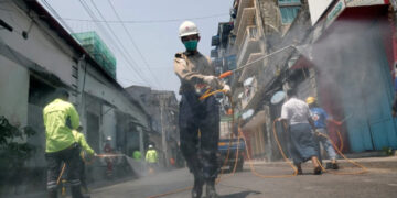A man disinfecting a street against the spread of coronavirus in Yangon, Myanmar.