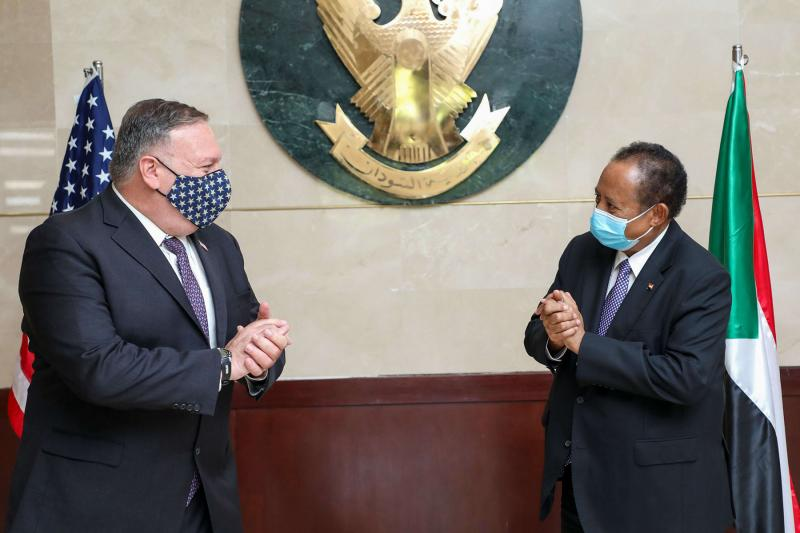 Former US Secretary of State Mike Pompeo (L) meets with Sudanese Prime Minister Abdalla Hamdok in Khartoum, last August