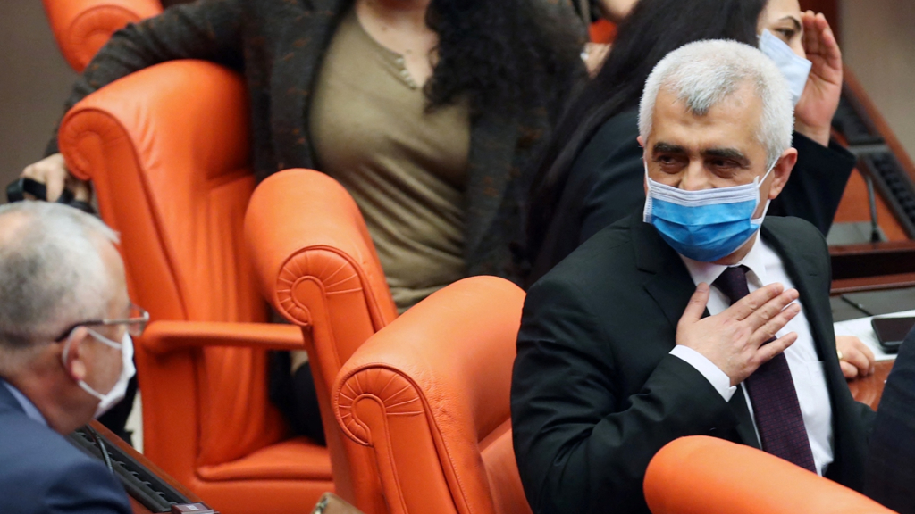 Turkish lawmaker for the pro-Kurdish Peoples' Democratic Party (HDP) Omer Faruk Gergerlioglu reacts after being expelled from his post.