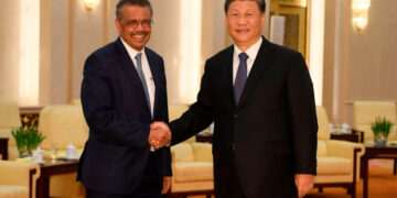 WHO director-general Adhanom Ghebreyesus shakes hands with Chinese President Xi Jinping in Beijing, January 28 2020.