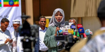 Members representing African communities in Yemen speak outside the offices of the International Organization for Migration in Sanaa, following last weekend's fire in a holding facility, March 14, 2021.